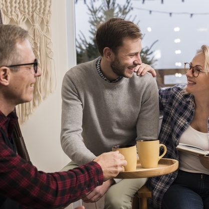 side-view-father-giving-mother-son-warm-cup_23-2148414872